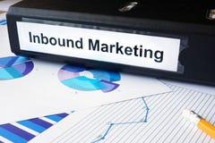 Grafici e cartella di archivio con l'introduzione sul mercato in arrivo dell'etichetta Immagini Stock