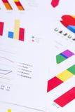 Grafici e numeri di affari Immagini Stock