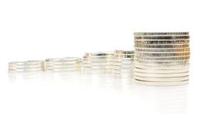 Grafico crescente fatto delle monete d'argento Fotografia Stock Libera da Diritti