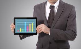 Grafico del touch screen della mano su una compressa Fotografie Stock Libere da Diritti
