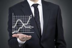 Grafico della tenuta dell'uomo d'affari Immagini Stock