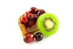 Grafico a torta di porco con il Kiwi e l'uva Immagini Stock