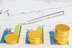 Grafiek en muntstukken Stock Afbeelding