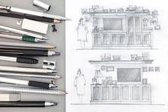 Grafische Zeichnungen von Schrankwänden auf Designerarbeitsplatzhintergrund Stockbild