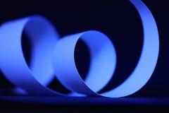 Grafisk krullning för blått papper Arkivfoto
