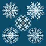 Grafisk vinteruppsättning av snöflingor Arkivfoto