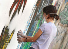Grafiti 02. Teenage spray painting on wall Royalty Free Stock Photos