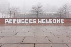 Grafiti d'accueil de réfugiés à Hambourg Allemagne Photos stock