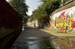 Grafitti along the Bushby Brook, Humberstone. Leicester Royalty Free Stock Photo