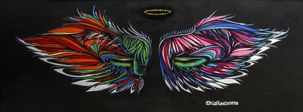 Grafitti av den oidentifierade konstnären på väggen av den Batman gränden Arkivfoton