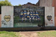 Grafitti av det Boca Juniors laget på La Boca Royaltyfri Foto