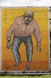 Grafitti av mannen med den snitthänder och foten Royaltyfria Bilder