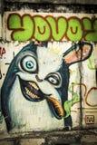 Grafitti av tecknade filmen som röker cigarren i Chiang Mai arkivbild