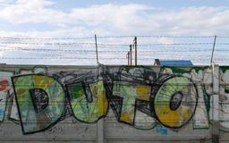 Grafitti and barbwire. Picture of a wall with barbwire covered with graffiti Stock Image