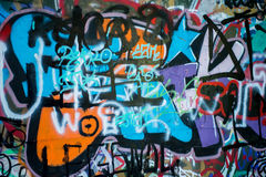 Grafitti colorful wall in the city. Background image of a urban grafitti wall stock photography