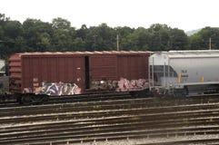 Grafitti covered rail car in rail yard in Md stock image