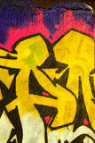 Grafitti Detail. Grunge background with detail of colorful graffiti on a concrete wall Stock Image