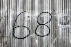 Grafitti för nummer 68 Royaltyfria Foton