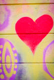 Grafitti with a heart on a concrete wall. In hippie style royalty free stock images
