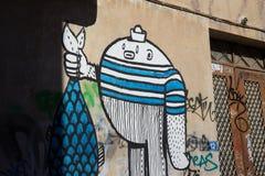 Grafitti i en liten gata i Plaka, Aten royaltyfri fotografi
