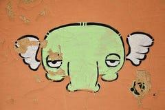 Grafitti på cementväggen Arkivbild