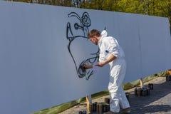 Grafitti på den vita väggen Royaltyfria Foton