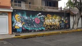 Grafitti på en vägg royaltyfri foto