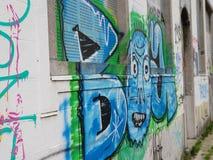 Grafitti på spökstaden Doel, Belgien royaltyfri bild