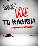 Grafitti på tegelstenväggen - SÄG INTE TILL RASISM stock illustrationer