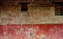 Grafitti at Pompeii. Grafitti on the walls of the ancient ruins of Pompeii stock images