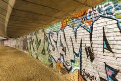 Grafitti under den Westway planskilda korsningen Royaltyfri Foto