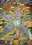 Grafitti wall. Colorful brick wall with big flower stock photos