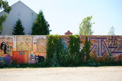 Grafitti wall. POZNAN, POLAND - AUGUST 02, 2015: Grafitti drawings and text on a brick wall stock images