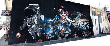Grafittiastronaut arkivfoto