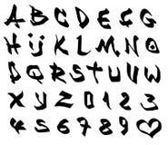 Grafittimarkörstilsort och nummeralfabet över vit Arkivfoton