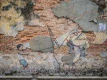 Grafittipojke som drar ett monster Royaltyfria Bilder