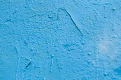 Grafittis azuis na textura da parede fotografia de stock royalty free