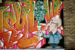 Grafittis bonitos BRITÂNICOS na parede, grafittis de Cambridge da rua Imagem de Stock