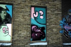 Grafittis bonitos BRITÂNICOS na parede, grafittis de Cambridge da rua Fotos de Stock