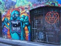 Grafittis com monstro e leão Fotos de Stock