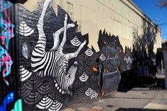 Grafittis com o cão da zebra e de salsicha Imagens de Stock Royalty Free