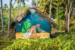 Grafittis da fantasia em uma parede da casa de campo indiana Fotografia de Stock