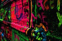 Grafittis de néon Imagens de Stock