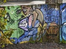 Grafittis do beijo Imagens de Stock