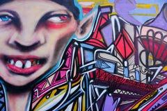 Grafittis em paredes em um corredor Fotografia de Stock Royalty Free