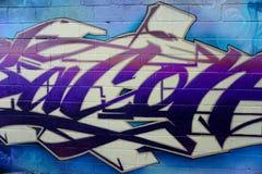 Grafittis em paredes em um corredor Fotos de Stock Royalty Free
