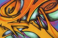 Grafittis em um muro de cimento Fotos de Stock