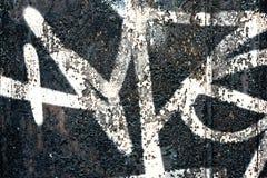 Grafittis em uma parede - detalhe de um grafitti pintado em uma parede Fotografia de Stock