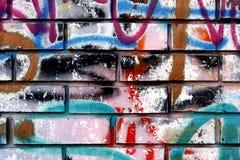 Grafittis em uma parede - detalhe de um grafitti pintado em uma parede Imagens de Stock Royalty Free
