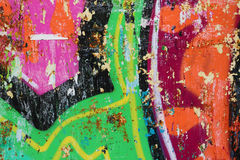 Grafittis em uma parede - detalhe de um grafitti pintado em uma parede Fotos de Stock